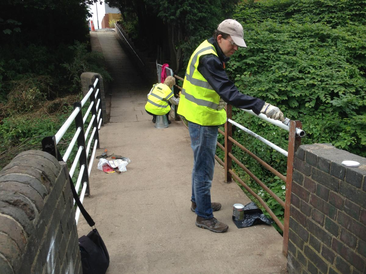 Volunteers painting the footbridge over the canal in August 2015